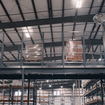 Pallets convey above the warehouse to finished goods storage within the AS/RS - Heaven Hill Distillery